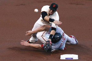 SAN FRANCISCO, CA - OCTOBER 15: Matt Holliday #7 of the St. Louis Cardinals slides into second knocking over Marco Scutaro #19 of the San Francisco Giants in the first inning of Game Two of the National League Championship Series at AT&T Park on October 15, 2012 in San Francisco, California. (Photo by Ezra Shaw/Getty Images)