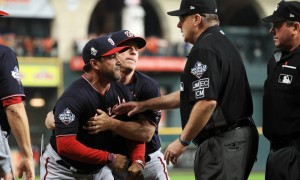 HOUSTON, TEXAS - OCTOBER 29:  Dave Martinez #4 of the Washington Nationals argues with umpire Gary Cederstrom #38 as he is ejected and is held back by Bob Henley #14 against the Houston Astros after the top of the seventh inning in Game Six of the 2019 World Series at Minute Maid Park on October 29, 2019 in Houston, Texas. (Photo by Mike Ehrmann/Getty Images) ORG XMIT: 775425079 ORIG FILE ID: 1184288825
