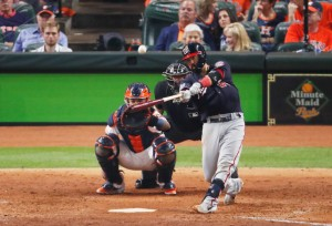 HOUSTON, TEXAS - OCTOBER 23: Kurt Suzuki #28 of the Washington Nationals hits a solo home run against the Houston Astros during the seventh inning in Game Two of the 2019 World Series at Minute Maid Park on October 23, 2019 in Houston, Texas. (Photo by Tim Warner/Getty Images)
